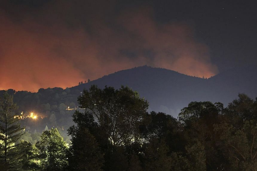 The Rim Fire expands in the hills behind Tuolumne City north-west of Yosemite National Park, California, on Aug 28, 2013. Yosemite National Park, faced with the spread of a massive California wildfire, extended a key road closure in the park on Wedne