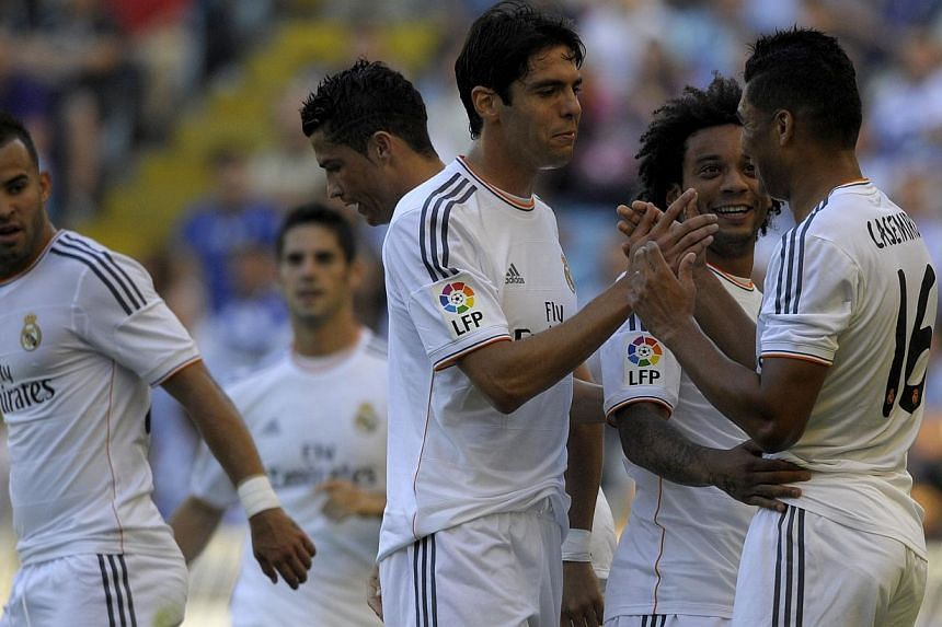 Real Madrid's Casemiro (right) celebrates with teammates after scoring a goal against Deportivo during the Trophy Teresa Herrera football match Deportivo La Coruna vs Real Madrid on Aug 29, 2013 at Riazor stadium in Galicia's La Coruna, north-western