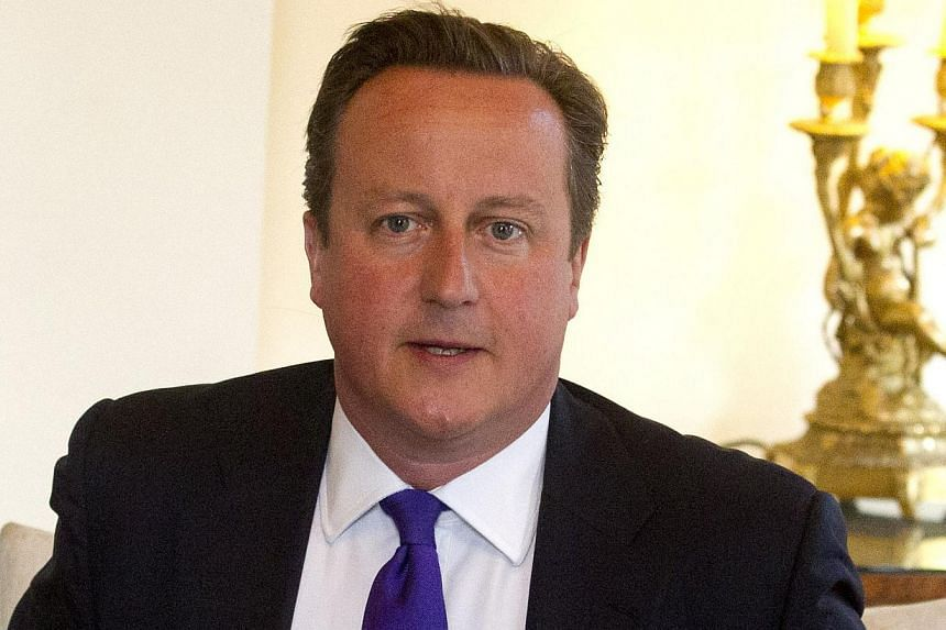 Britain's Prime Minister David Cameron at 10 Downing Street in London, on Friday, Aug 30 2013. Mr Cameron's authority was being questioned on Saturday following his stunning parliamentary defeat on action against the Syrian regime. -- FILE PHOTO: AP