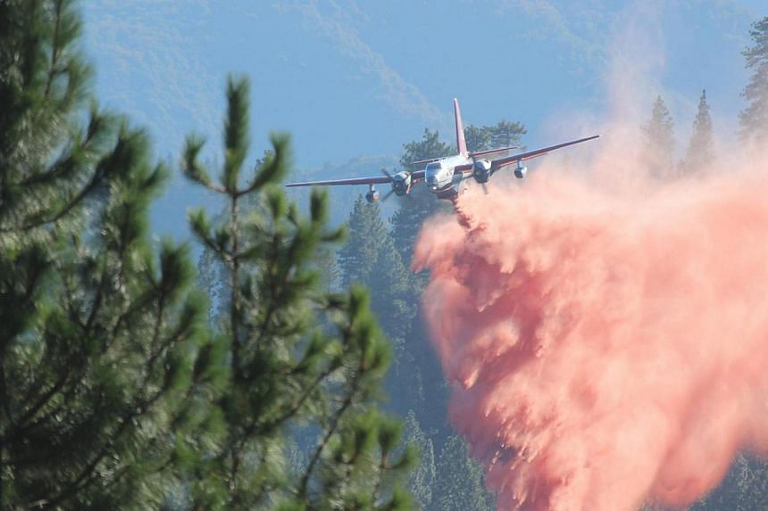A tanker drops retardant on the Rim Fire in this undated United States Forest Service handout photo near Yosemite National Park, California, released to Reuters on Aug 30, 2013. Fire crews battling to outflank a monster wildfire inside Yosemite Natio