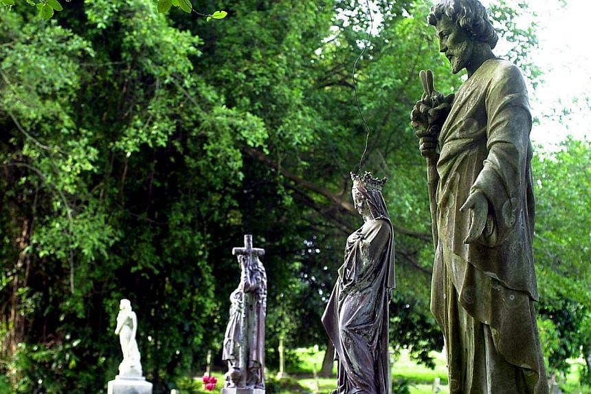 Statues that adorn almost every tombstone at the Bidadari Christian Cemetery. Some of these are brought in from Italy and cost between $2,000 and $7,000. -- NP FILE PHOTO: DOMINIC YING