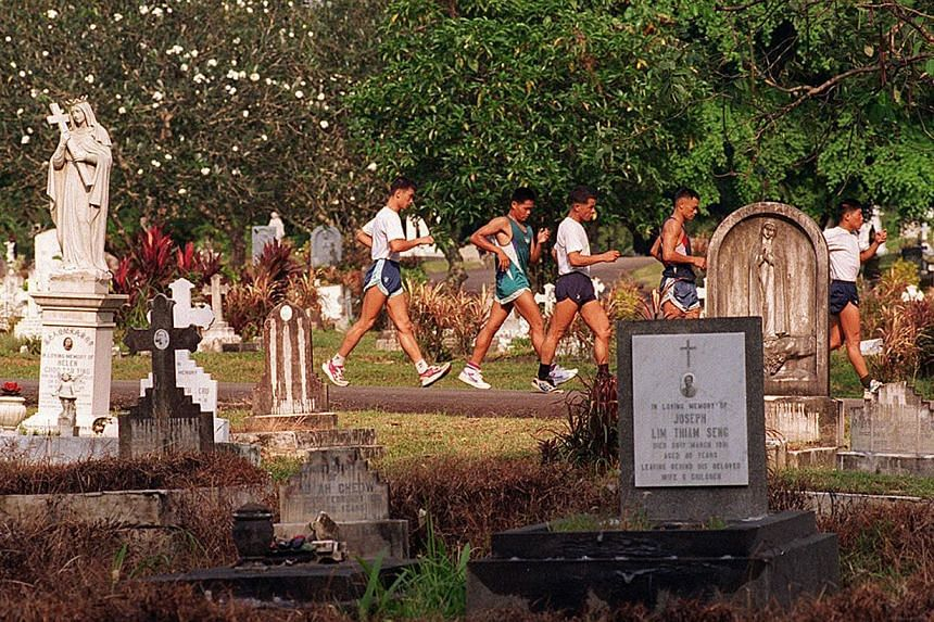 Bidadari Christian Cemetery stirs to life in the evening when joggers turn the place into a park of sorts, and maids from nearby houses bring their wards for an after-dinner walk. -- ST FILE PHOTO: GEORGE GASCON