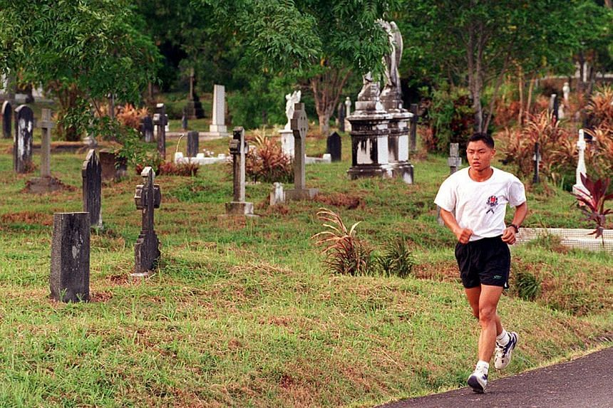 The tranquil and serene surroundings of Bidadari Cemetery is a favourite with joggers. -- ST FILE PHOTO: ALPHONSO CHAN