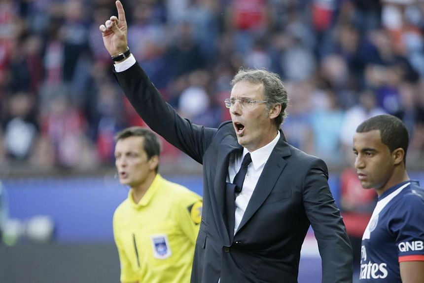 Paris Saint-Germain's coach Laurent Blanc gestures during the French L1 football match between Paris Saint-Germain (PSG) and Guingamp at the Parc des Princes stadium in Paris, on Aug 31, 2013. PSG boss Blanc extended his best wishes to wantaway defen