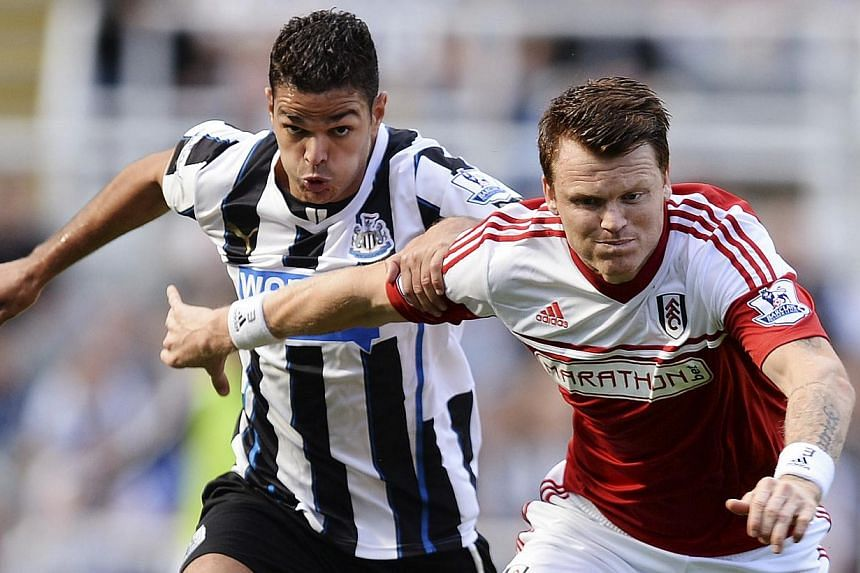 Fulham's John Arne Riise (right) challenges Newcastle United's Hatem Ben Arfa during their English Premier League soccer match at St James' Stadium in Newcastle, northern England, on Aug 31, 2013. Ben Arfa left it late to fire Newcastle to their firs