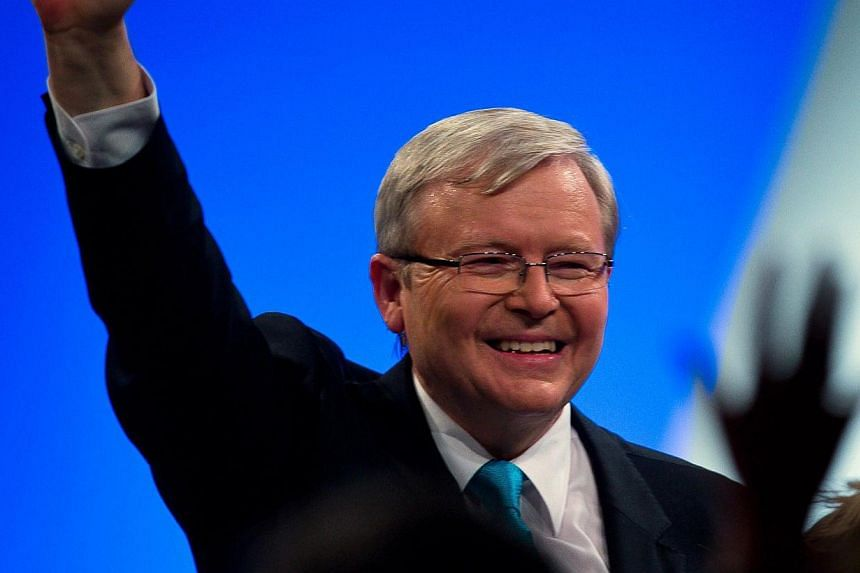 """Australia's Prime Minister Kevin Rudd salutes the party faithful at the official launch of the Labor Party's federal campaign at the Brisbane Convention Centre on Sept 1, 2013. Mr Rudd vowed to fight until """"the last vote is cast"""" in a rousing speech"""