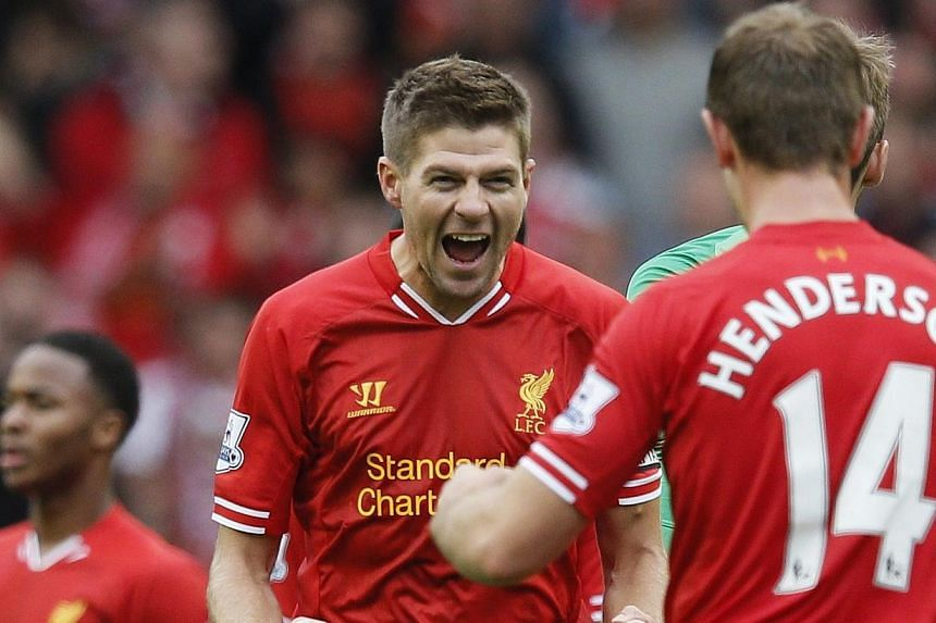 Liverpool's Steven Gerrard (centre) reacts after their English Premier League soccer match against Manchester United at Anfield, Liverpool, northern England  on Sunday, Sept 1, 2013. Daniel Sturridge marked his 24th birthday with the winnin