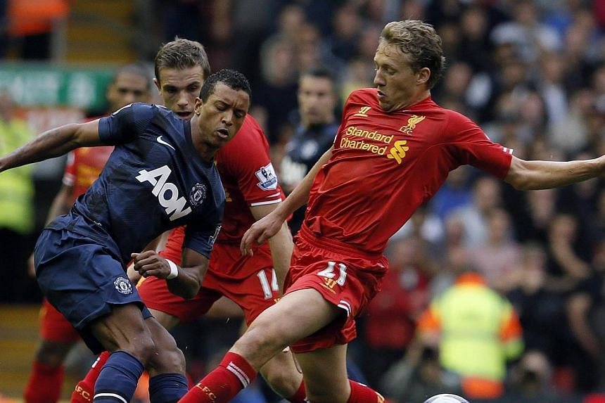 Liverpool's Lucas (right) challenges Manchester United's Nani during their English Premier League soccer match at Anfield, Liverpool, northern England on Sunday, Sept 1, 2013. Daniel Sturridge marked his 24th birthday with the winning goal