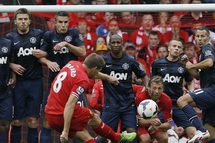 Liverpool's Steven Gerrard (centre) takes a free kick during their English Premier League soccer match against Liverpool at Anfield, Liverpool, northern England on Sunday, Sept 1, 2013. Daniel Sturridge marked his 24th birthday with the win