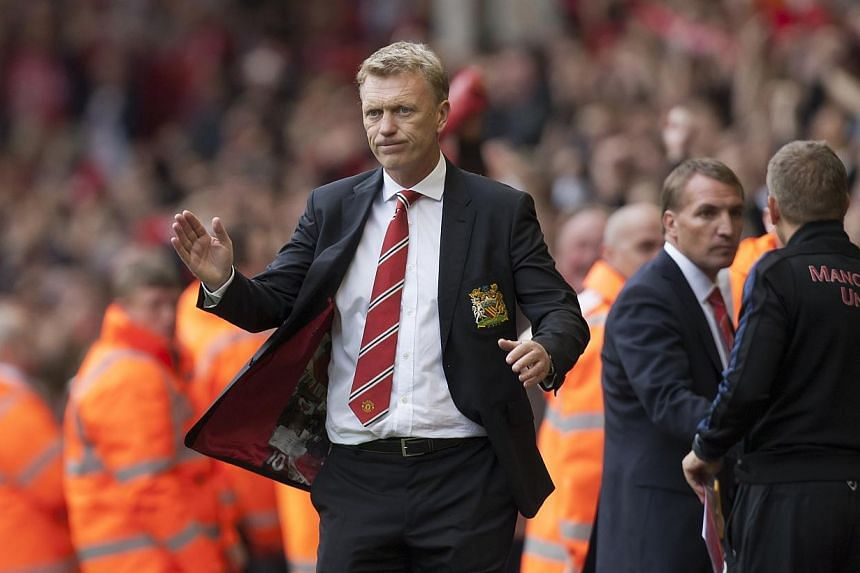 Manchester United's manager David Moyes (centre) reacts after his team's 1-0 loss at Liverpool in their English Premier League soccer match at Anfield Stadium, Liverpool, England on Sunday, Sept 1, 2013. -- PHOTO:AP