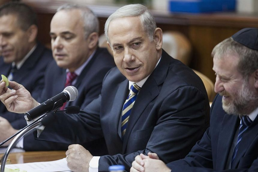 """Israeli Prime Minister Benjamin Netanyahu said on Sunday that the Jewish State was prepared for """"every posssible scenario"""" in neighbouring Syria after US President Barack Obama postponed a threatened missile strike.-- PHOTO: REUTERS"""