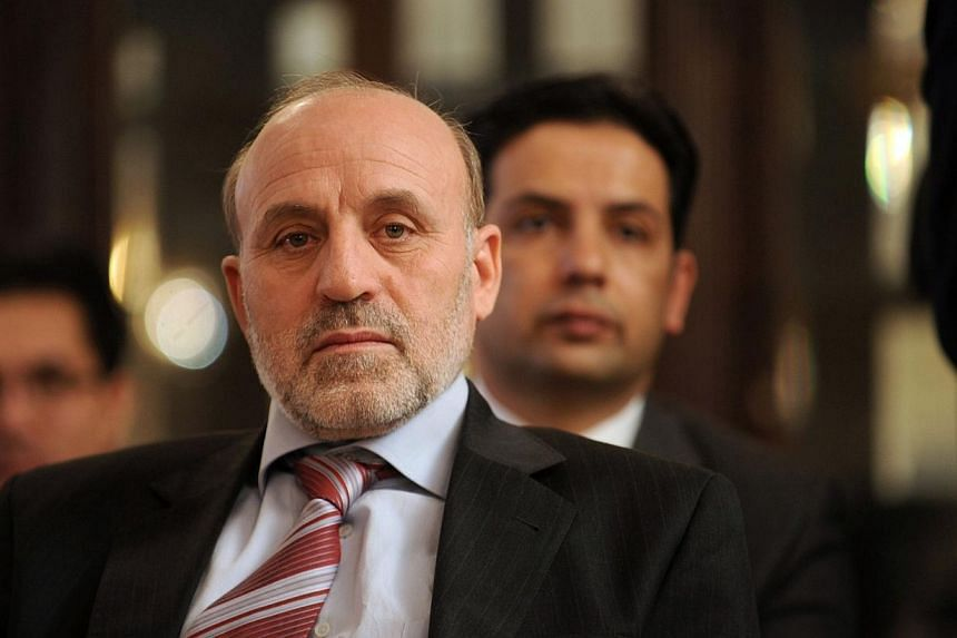 Probable presidential candidate Omar Daudzai (front) was appointed as Afghanistan's acting interior minister on Sunday, putting him in a high-profile public role seven months before the country's first democratic transfer of power. -- FILE PHOTO: AFP