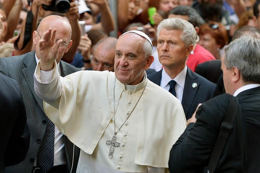 Pope Francis (centre) waves to Rome's citizens upon his arrival at the Church of Saint Augustine in downtown Rome on Wednesday, Aug 28, 2013.Pope Francis has called for a day of fasting and prayer around the world next Saturday for peace in Syr