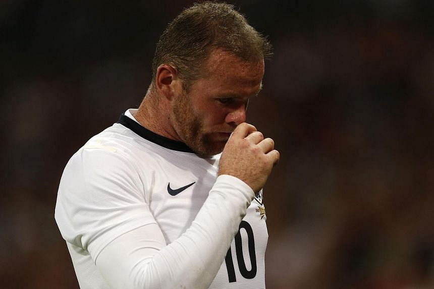 Manchester United striker Wayne Rooney has suffered a head injury during training and is doubtful for Sunday's English Premier League clash with bitter rivals Liverpool, according to British media reports. --  FILE PHOTO: REUTERS