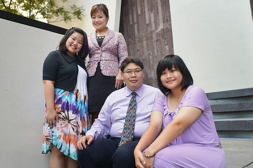 Indonesian Erick Oei, 44, with his wife, Madam Luana Wati Halim, 42, and daughters Samantha Gedalya (left), 12, and Shanice Abigail, 16. Madam Luana and her daughters became Singapore citizens last year. -- ST PHOTO: ALPHONSUS CHERN