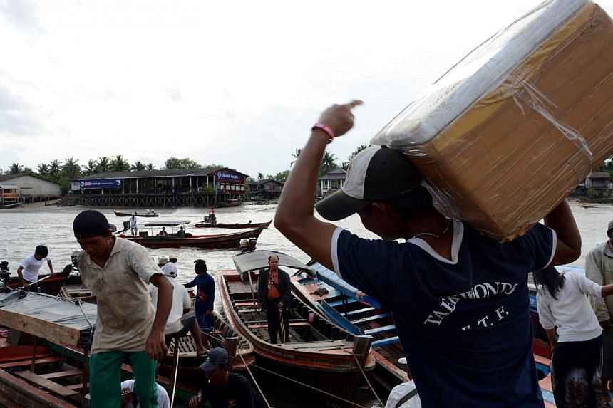 The jetty at Ranong, a border town in southern Thailand, is bustling with activity. Ranong is a major transit point for Burmese migrants seeking jobs. -- ST PHOTO: TAN HUI YEE