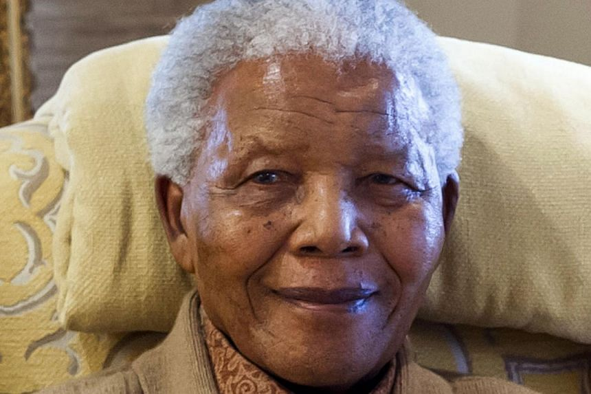 Anti-apartheid leader and former South African President Nelson Mandela was discharged from hospital and returned home on Sunday after being treated for a recurring lung infection, the government said in a statement. -- FILE PHOTO: AFP/CLINTON FOUNDA
