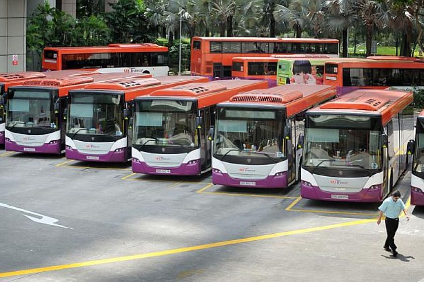 SBS Transit buses at the Toa Payoh bus interchange. Some 111 bus routes, or two in five services, have been improved since a $1.1 billion bus plan was launched last September. -- ST FILE PHOTO: ALPHONSUS CHERN