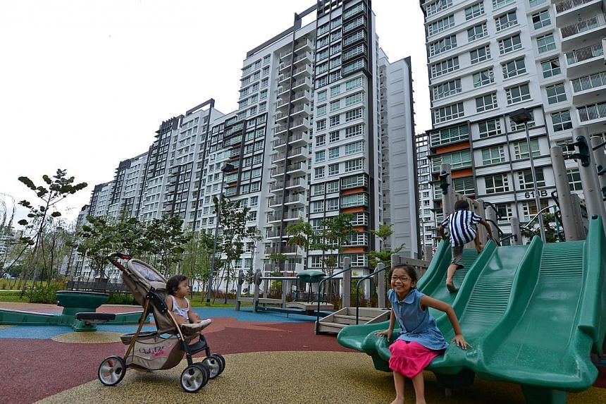 Children in the playground near the recently completed Punggol Breeze. -- ST FILE PHOTO: CAROLINE CHIA