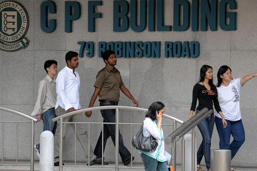 Workers outside CPF Building in the financial district area. Singapore has made some progress in helping international organisations such as the Organisation for Economic Co-operation and Development (OECD) to better understand the local Central