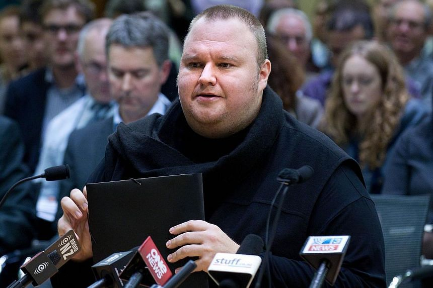 MegauplMegaupload founder Kim Dotcom speaks as he comes face to face for the first time with New Zealand Prime Minister John Key as lawmakers examine a controversial proposal allowing intelligence agencies to spy on local residents at Bowen House in