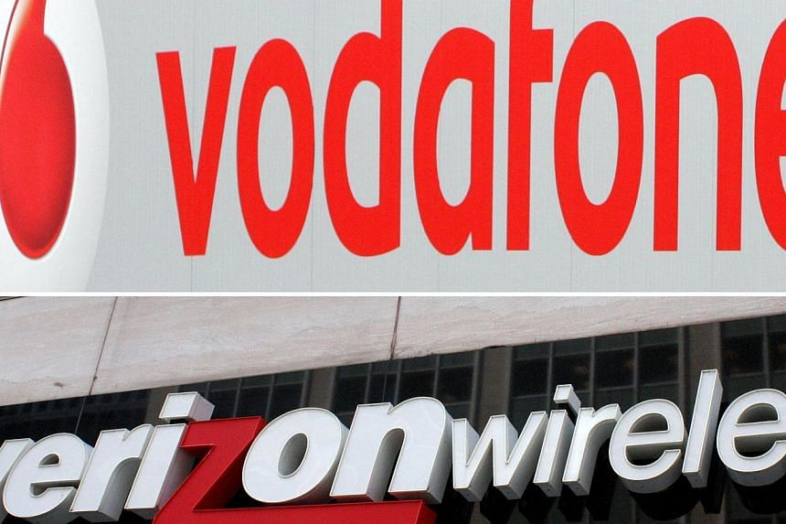 A combination of pictures created on Aug 29, 2013 shows the logo for Verizon Wireless (bottom) in Washington DC on June 2, 2010 and the logo of mobile network provider Vodafone in Hanover March,14 2007. British telecoms giant Vodafone has agreed to s