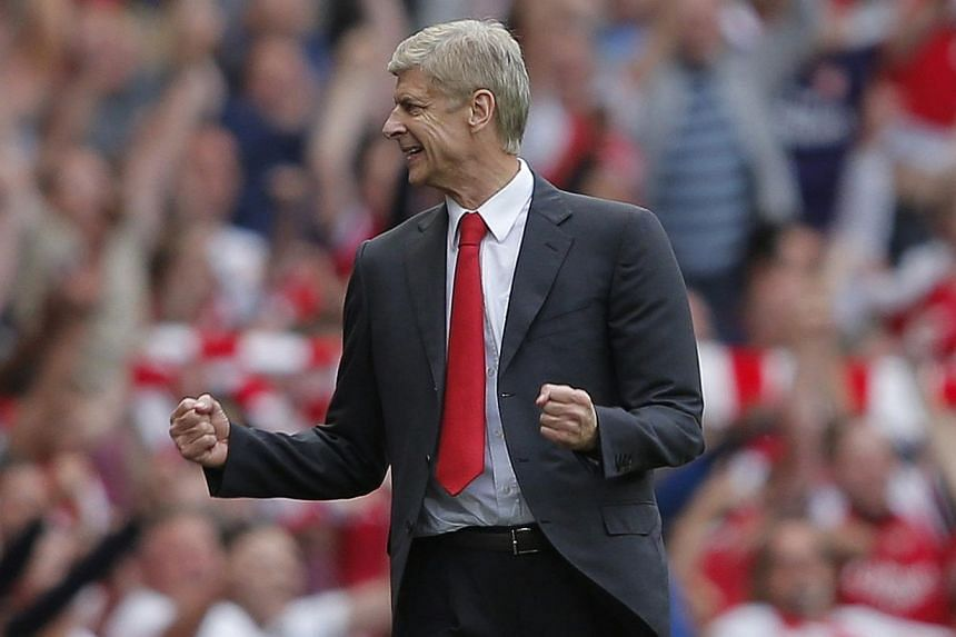Arsenal's manager Arsene Wenger reacts on the final whistle during their English Premier League soccer match against Tottenham Hotspur at the Emirates, London, England on Sept 1, 2013.Arsene Wenger insists Arsenal's 1-0 win over north London ri