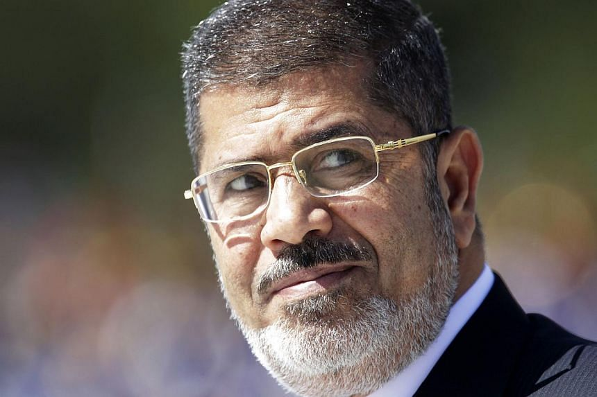 Egypt's President Mohamed Mursi reviews troops in an official ceremony before a meeting with Brazil's President Dilma Rousseff at the Planalto Palace in Brasilia in this May 8, 2013 file photo. Ousted Egyptian president Mohamed Mursi is to stand tria