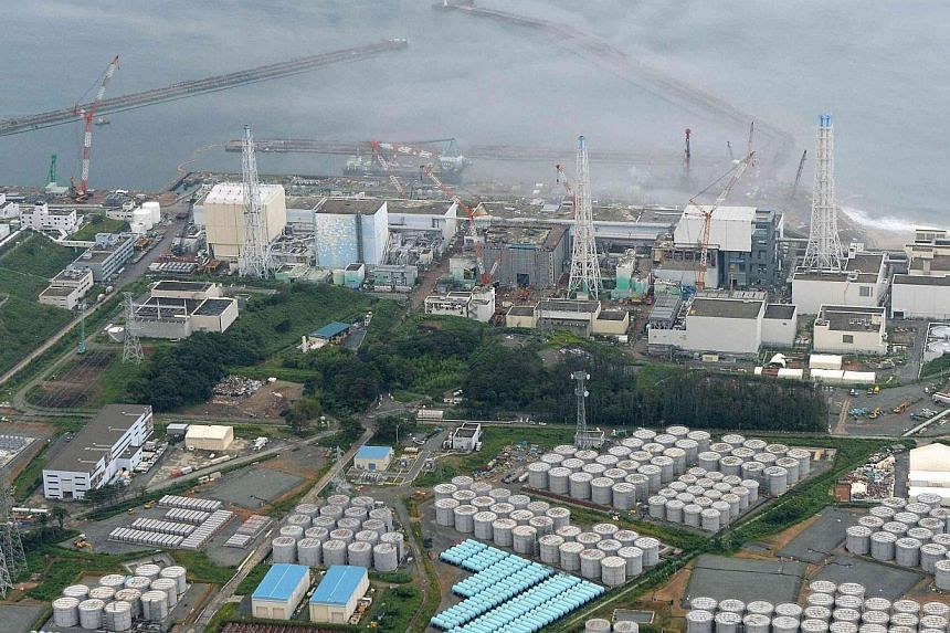 An aerial view shows Tokyo Electric Power Co. (Tepco)'s tsunami-crippled Fukushima Daiichi nuclear power plant and its contaminated water storage tanks (bottom) in Fukushima, in this file photo taken by Kyodo Aug 20, 2013. Japan's nuclear regulator r