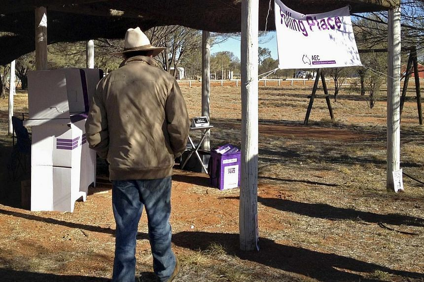 The only registered voter at the outstation of Artekerre, located around 50km north of Alice Springs, in Australia's Northern Territory, walks towards the mobile polling station in this picture taken Aug 26, 2013. -- FILE PHOTO: REUTERS