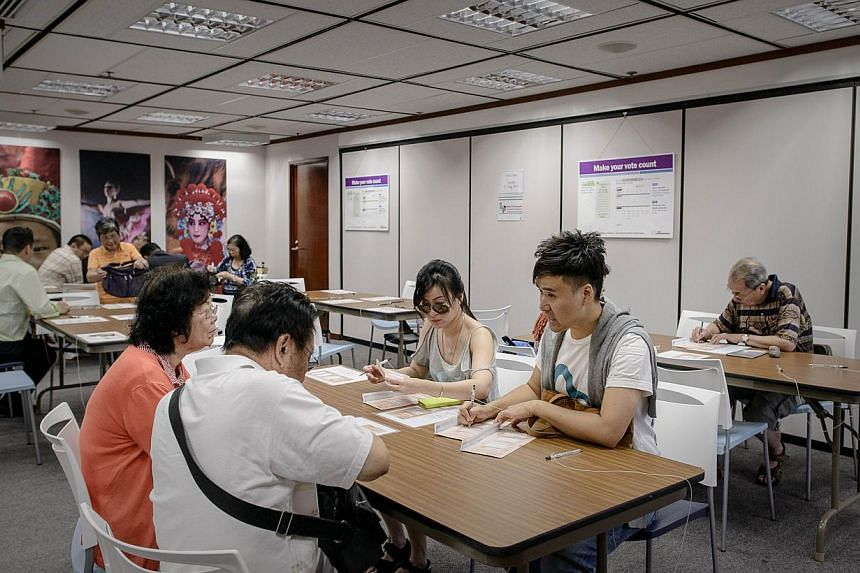 Voters fill ballots at the voting centre of the Australian Consulate-General in Hong Kong on Aug 27, 2013. Australians in Hong Kong started to vote on Aug 26, 2013 for Australia's 2013 Federal Election. -- FILE PHOTO: AFP