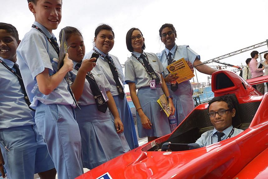 Woodlands Secondary students witha Formula BMW car, which is now used for extrication exercises in training, at the Pit area during the tour.With the 2013 Formula One SingTel Singapore Grand Prix less than three weeks away, race organiser