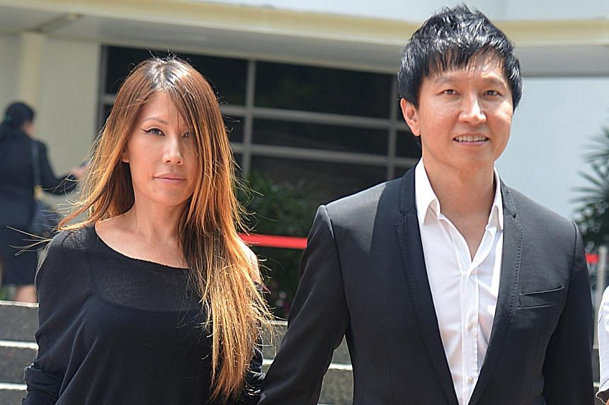 Kong Hee (right), founder of City Harvest Church (CHC), walks hand-in-hand with his wife, singer Ho Yeow Sun, outside the Subordinate Courts on Aug 28, 2013. Kong Hee has spoken out against the hacker who attacked his wife's website on Monday, S
