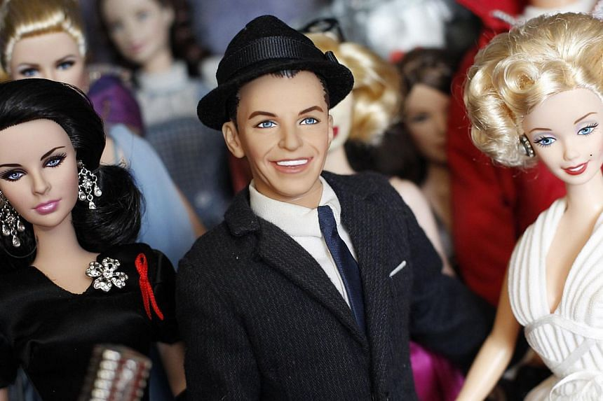 (From left) Barbie dolls in the likeness of Elizabeth Taylor, Frank Sinatra and Marilyn Monroe are displayed in doll collector Jian Yang's home in Singapore on Monday, Sept 2, 2013. -- PHOTO: REUTERS