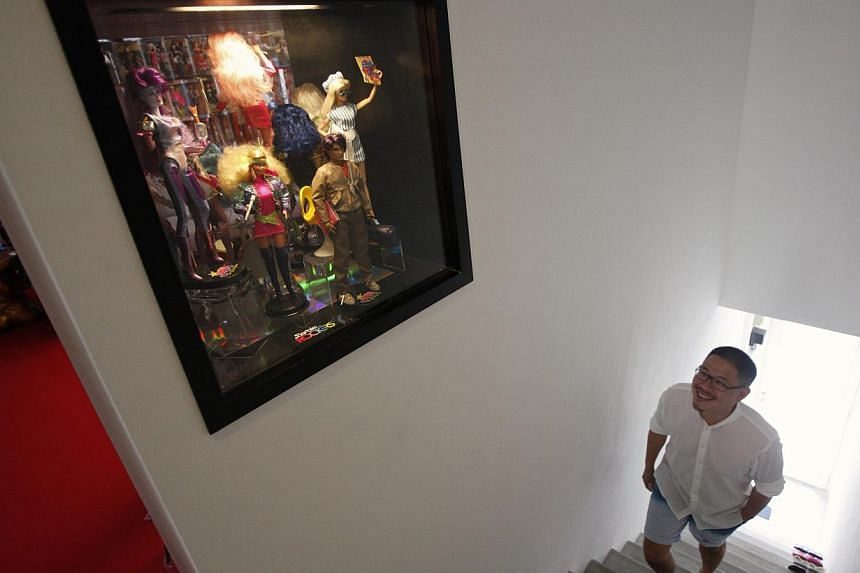 Doll collector Jian Yang walks up the stairs of his apartment in Singapore on Monday, Sept 2, 2013. -- PHOTO: REUTERS