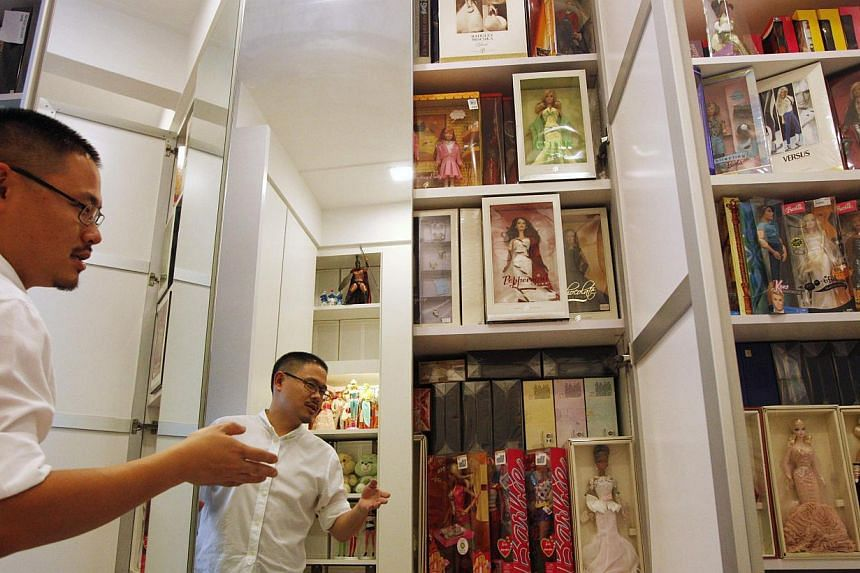 Doll collector Jian Yang shows his wardrobes filled with his collection at his home in Singapore on Monday, Sept 2, 2013. -- PHOTO: REUTERS