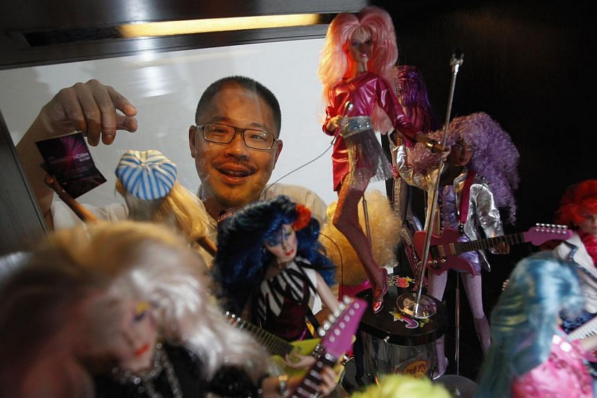 Doll collector Jian Yang at his home in Singapore on Monday, Sept 2, 2013. -- PHOTO: REUTERS