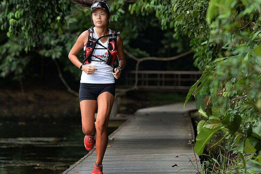 Ms Goh J-ing (above) will take part in the Sundown Ultra Marathon to raise awareness of cancer, while manager Eddy Lee wants to celebrate the life of long-time friend Wendy Ng. -- PHOTOS: RAJ NADARAJAN, COURTESY OF EDDY LEE