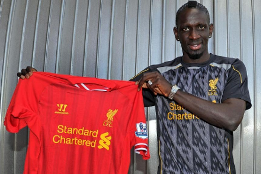 Liverpool have signed France international defender Mamadou Sakho (above) and Portuguese centre-back Tiago Ilori, as the pair became the first confirmed arrivals at an English Premier League football club on Monday's transfer deadline day. -- PHOTO: