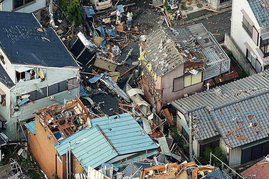 An aerial view shows damaged houses caused by a tornado in Koshigaya, north of Tokyo, in this photo taken by Kyodo on Monday, Sept 2, 2013. -- PHOTO: REUTERS / KYODO