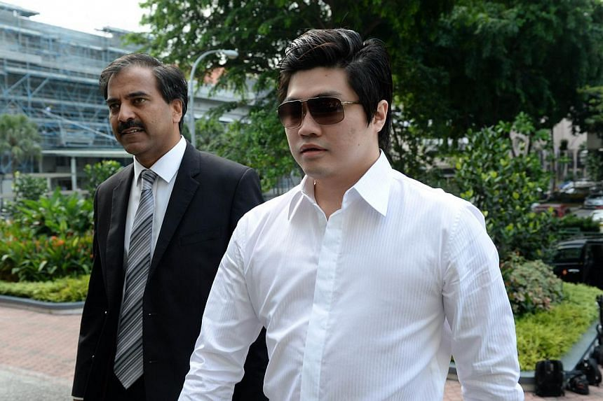 Singaporean businessman Eric Ding Si Yang (right) arrives with his lawyer for a trial at the Subordinate courts in Singapore on Monday, Sept 2, 2013.One of seven phones seized from alleged matchfixer Ding came under scrutiny on Monday, as a for
