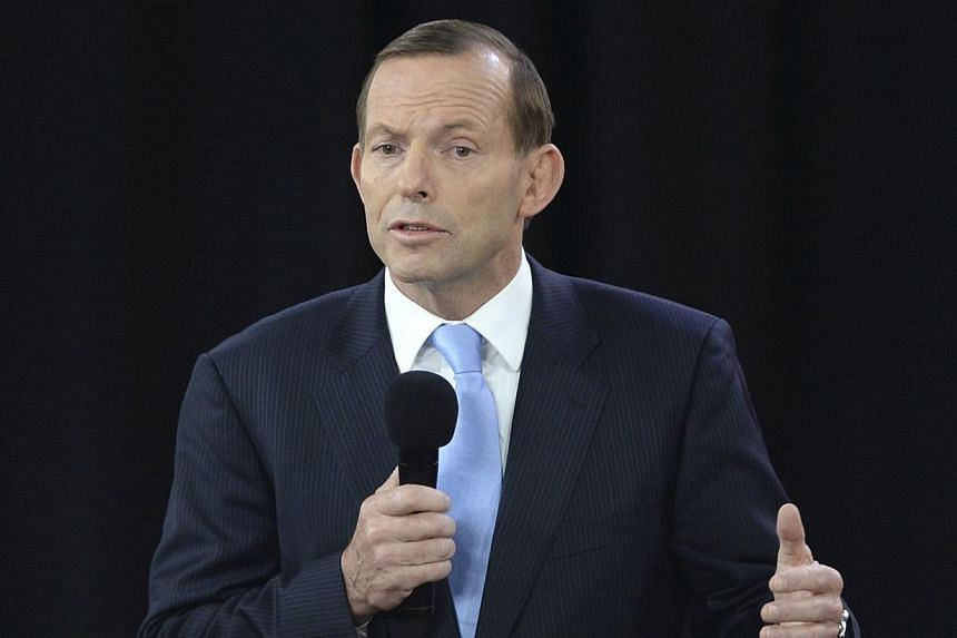 "Australia's likely next prime minister Tony Abbott on Monday defended his ""baddies versus baddies"" description of Syria as he was accused of graduating from the ""John Wayne school of international relations"". -- FILE PHOTO: AP"