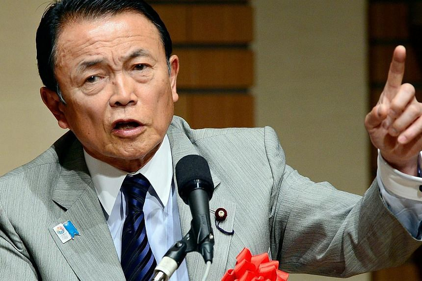 This file picture taken on June 28, 2013 shows Japanese finance and deputy Prime Minister Taro Aso at a press conference in Tokyo. Japan will tell G-20 nations at a summit this week that it plans to go ahead with a two-stage sales tax hike from next