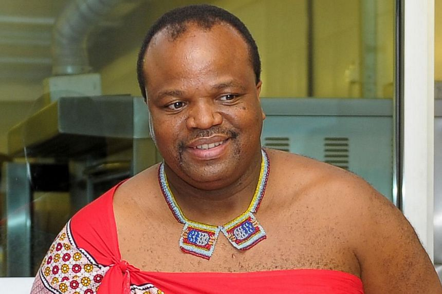 """King Mswati III of Swaziland smiles during his visit to Taylor's University in Subang Jaya, outside Kuala Lumpur on July 3, 2013. Africa's last absolute monarch has declared his tiny mountain kingdom has a new political system - a """"monarchial democra"""