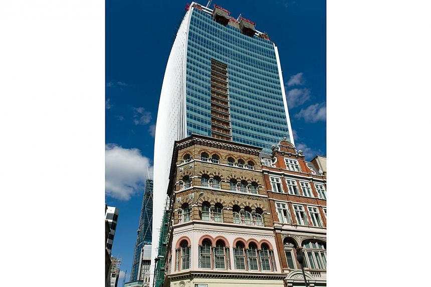"""General view of the """"Walkie Talkie"""" tower which has been creating a shaft of intense sunlight reflected from it's glass windows onto the streets below in central London on August 30, 2013.The skyscraper's developers said they were seeking to re"""