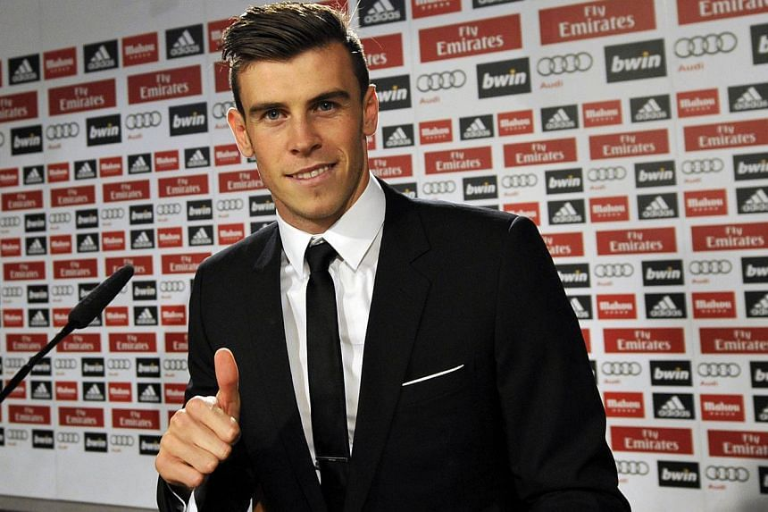 Real Madrid's new Welsh striker Gareth Bale gives the thumbs-up at the press conference for his presentation at the Santiago Bernabeu stadium in Madrid on Sept 2, 2013. Bale insists he will not be overcome by the pressure of his huge price tag after