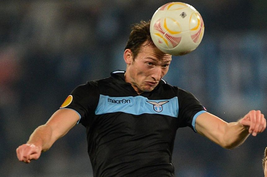 In this file picture taken on Nov 22 , 2012 Lazio's Czech forward Libor Kozak jumps for the ball during their Europa League football match against Tottenham Hotspur at the Olympic stadium in Rome. Aston Villa bolstered their forward line by signing K