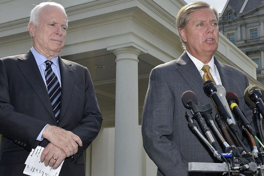 US Senator Lindsey Graham (right), makes remarks to the media as US Senator John McCain (left), listens, after meeting with U.S. President Barack Obama at the White House, on possible military action against Syria, in Washington Sept 2, 2013. &n