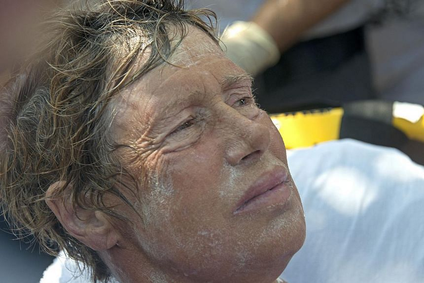 Diana Nyad receives medical treatment after completing a 179km swim from Cuba to Key West, Florida, on Sept 2, 2013. The 64-year-old American swam into the history books on Monday, completing a marathon three-day crossing from Cuba to Florida to beco