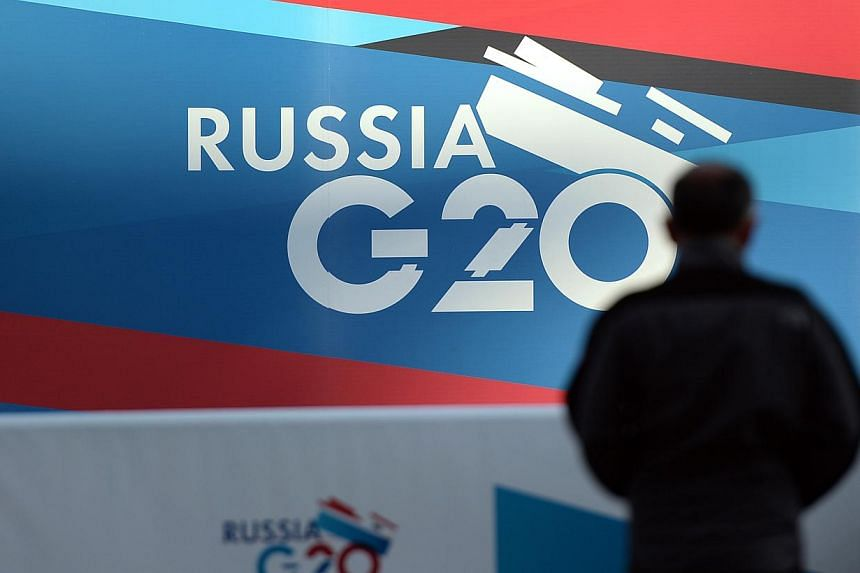 Banners bearing the logo of the upcoming Russia G20 Leaders' Summit 2013 are seen along the Neva River in St Petersburg, Russia on Tuesday, Sept 3, 2013.Russia on Thursday, Sept 5, 2013, hosts the G20 summit hoping to push forward an agenda to